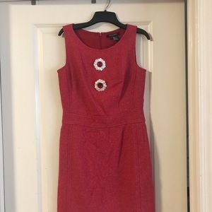 Reddish colored dress preowned in good condition.